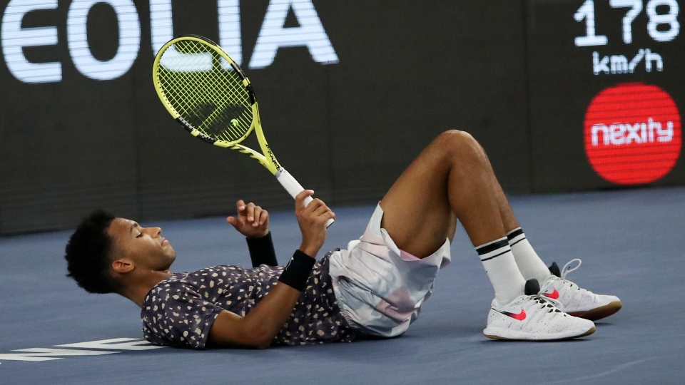 Felix Auger-Aliassime slips in the final