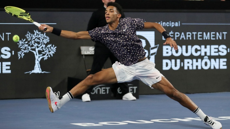 Felix Auger-Aliassime of Canada plays a shot against Stefanos Tsitsipas of Greece in the men's singles final of the Open 13 Provence tennis tournament in Marseille, southern France, Sunday, Feb. 23, 2020. (AP Photo/Daniel Cole)