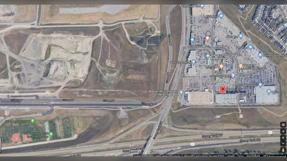 Police say a vehicle was heading east on 112th Avenue N.W. when it failed to make a curve, crossed Sarcee Trail and went over an embankment, landing upside down in the Home Dept parking lot. The driver, a 44-year-old man, was pronounced deceased at the scene. (Google Maps)