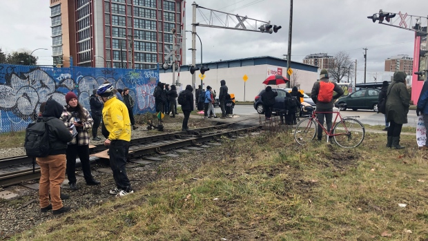 Protesters leave train tracks in East Vancouver after police read injunction