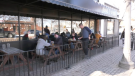 Diners sit on the patio at the Next Act Pub on Feb. 23, 2020.
