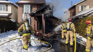 Fire crews were called to a two-storey home on East Acres Road around 12:49 a.m. after a car caught fire. The flames quickly spread to the home. (Courtesy: Scott Stilborn/Twitter @OFSFirePhoto)