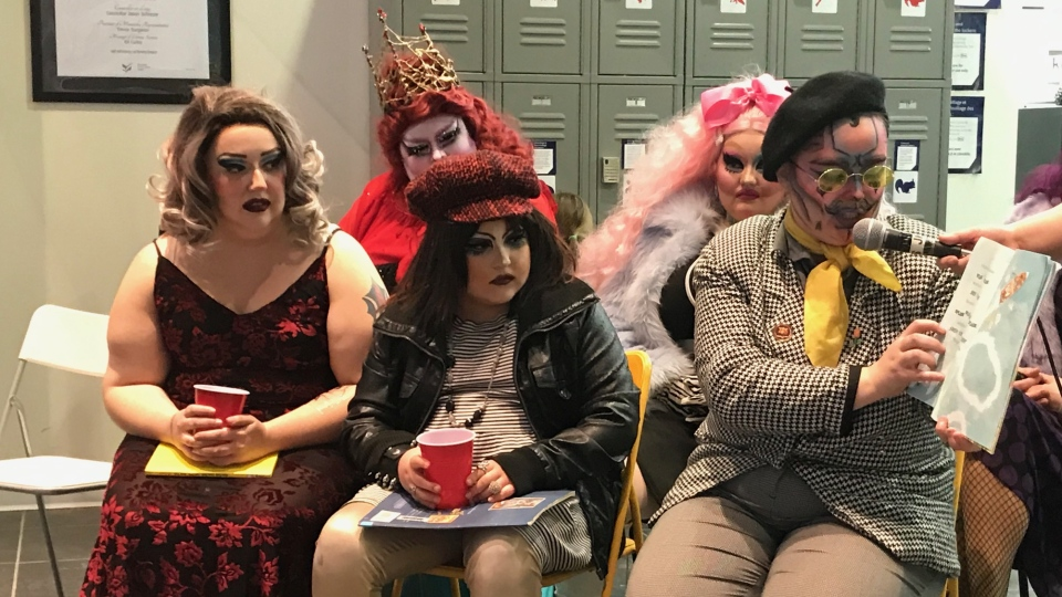 Local drag queens and king read children stories at Millennium Library while protesting its security screening measures.