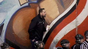 Coach returns to rink after transplant