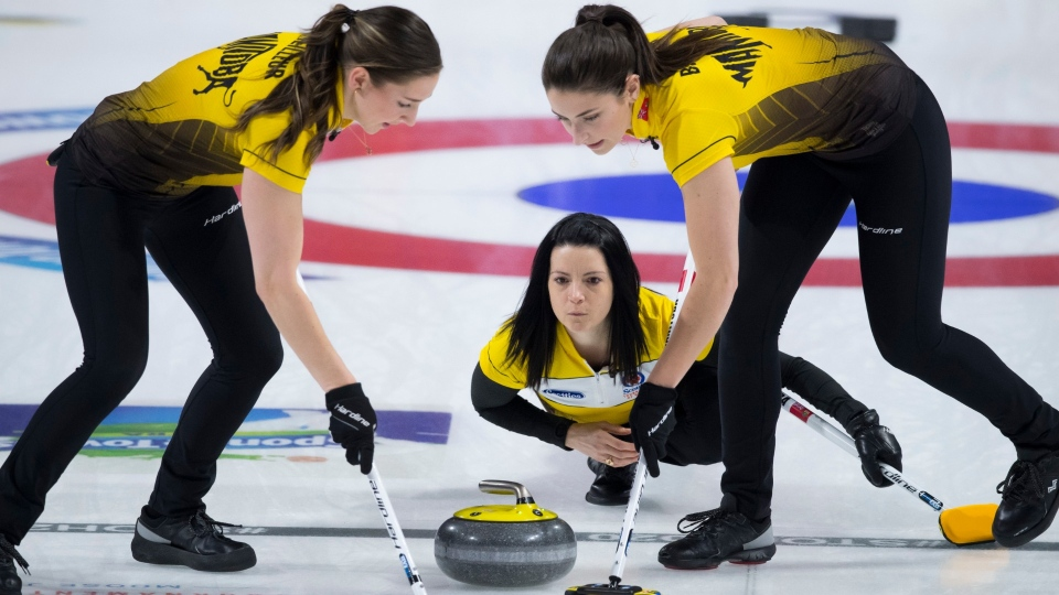 Team Manitoba skip, Kerri Einarson makes a shot as lead, Briane Meilleur and second, Shannon Birchard sweep during curling final action against Team Ontario at the Scotties Tournament of Hearts in Moose Jaw, Sask., Sunday, February 23, 2020. (THE CANADIAN PRESS/Jonathan Hayward)