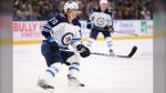 Winnipeg Jets forward Cody Eakin (20) skates during the first period of an NHL hockey game against the Buffalo Sabres, Sunday, Feb. 23, 2020, in Buffalo, N.Y. (AP Photo/Jeffrey T. Barnes)