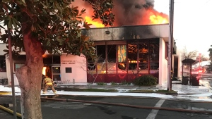 FILE - In this Tuesday, Feb. 18, 2020 file photo, flames engulf the public library in Porterville, Calif. (Charles Whisnand/The Porterville Recorder via AP, File)