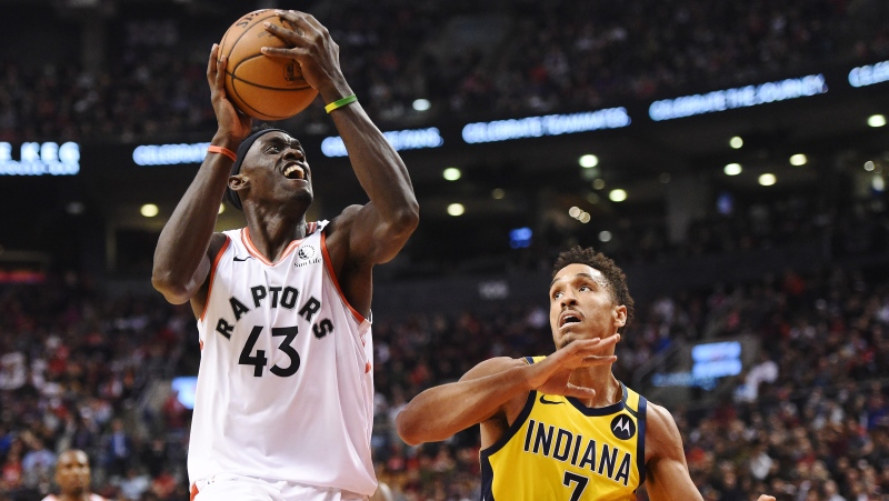 Toronto Raptors forward Pascal Siakam (43) drives past Indiana Pacers guard Malcolm Brogdon (7) during first half NBA basketball action in Toronto on Sunday, Feb. 23, 2020. THE CANADIAN PRESS/Frank Gunn