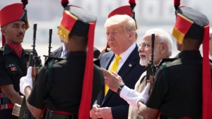U.S. President Donald Trump is greeted by Indian Prime Minister Narendra Modi upon arrival at Sardar Vallabhbhai Patel International Airport, Monday, Feb. 24, 2020, in Ahmedabad, India. (AP Photo/Alex Brandon)