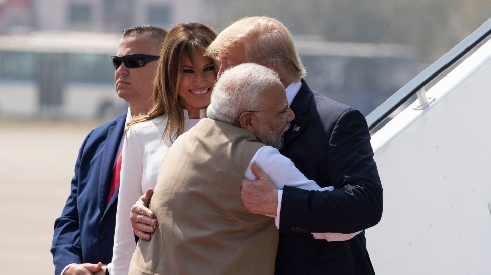 U.S. President Donald Trump is greeted by Indian Prime Minister Narendra Modi, with first lady Melania Trump, as they step off Air Force One upon arrival at Sardar Vallabhbhai Patel International Airport, Monday, Feb. 24, 2020, in Ahmedabad, India. (AP Photo/Alex Brandon)