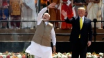 U.S. President Donald Trump and Indian Prime Minister Narendra Modi wave to the crowd at Sardar Patel Stadium in Ahmedabad, India, Monday, Feb. 24, 2020. (AP Photo/Aijaz Rahi)