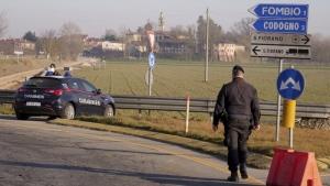 Carabinieri (Italian paramilitary police) officers set a road block in Codogno, Northern Italy, Monday, Feb. 24, 2020. (AP Photo/Paolo Santalucia)