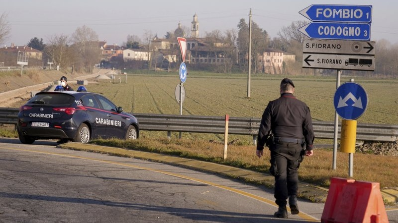Carabinieri (Italian paramilitary police) officers set a road block in Codogno, Northern Italy, Monday, Feb. 24, 2020. (AP Photo/Paolo Santalucia)