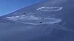 Close call as snowmobiler caught in avalanche