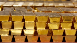 In this Tuesday, July 22, 2014, file photo, gold bars are stacked in a vault at the United States Mint, in West Point, N.Y. (AP Photo/Mike Groll, File)
