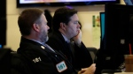 A pair of traders work on the floor of the New York Stock Exchange, Monday, Feb. 24, 2020. Markets are down across Europe and Asia, while futures for U.S. benchmarks have also dropped sharply. (AP Photo/Richard Drew)