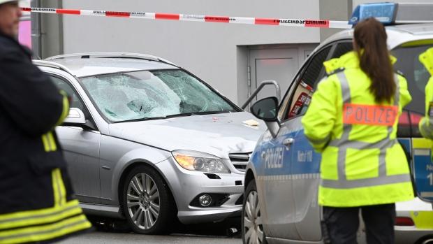 Car hits crowd at German carnival, dozens injured including children
