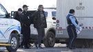 Ontario Provincial Police officers make an arrest at a rail blockade in Tyendinaga Mohawk Territory, near Belleville, Ont., on Monday Feb. 24, 2020, as they protest in solidarity with Wet'suwet'en Nation hereditary chiefs attempting to halt construction of a natural gas pipeline on their traditional territories. THE CANADIAN PRESS/Adrian Wyld