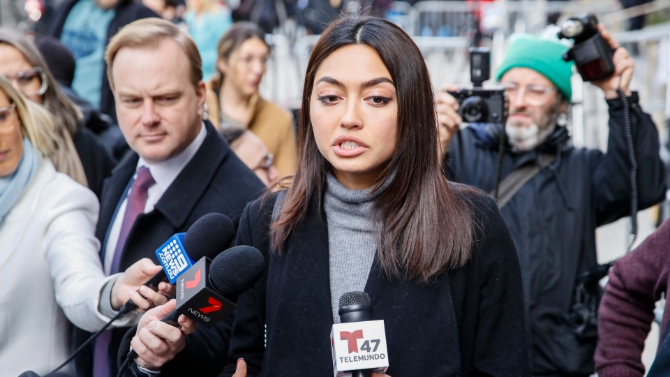 Ambra Battilana Gutierrez speaks to reporters outside of a Manhattan courthouse after Harvey Weinstein is convicted in his rape trial, Monday, Feb. 24, 2020, in New York. A jury convicted Weinstein of rape and sexual assault. The jury found him not guilty of the most serious charge, predatory sexual assault, which could have resulted in a life sentence. (AP Photo/John Minchillo)