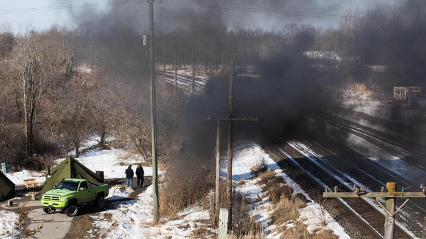Thick smoke can be seen near a second blockade in Tyendinaga Mohawk Territory, near Belleville, Ont., on Monday Feb. 24, 2020, as they protest in solidarity with Wet'suwet'en Nation hereditary chiefs attempting to halt construction of a natural gas pipeline on their traditional territories. THE CANADIAN PRESS/Lars Hagberg