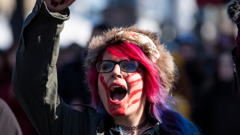A protester marches in a rally in solidarity with Wet'suwet'en hereditary chiefs opposed to the Coastal GasLink Pipeline, in Ottawa on Monday, Feb. 24, 2020. (Justin Tang/THE CANADIAN PRESS)
