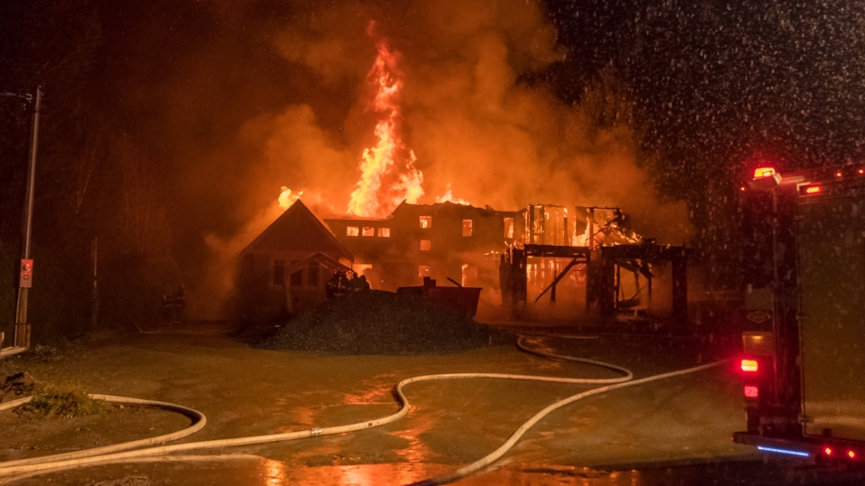 Crews were called around 3:30 a.m. to a home that was under construction and discovered that the flames had already engulfed the garage and upper floor of the house on Bay Drive .(Jim Murray)