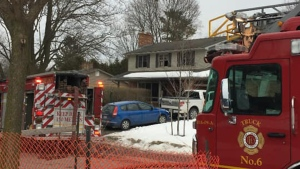 Firefighters work at the scene of a fire on Wychwood Park in London, Ont. on Monday, Feb. 24, 2020. (Brian Snider / CTV London)