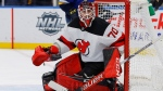 New Jersey Devils goaltender Louis Domingue defends the net during the second period of an NHL hockey game against the St. Louis Blues Tuesday, Feb. 18, 2020, in St. Louis. With Jacob Markstrom nursing a lower-body injury, the Vancouver Canucks have added some goaltending insurance. THE CANADIAN PRESS/AP, Billy Hurst
