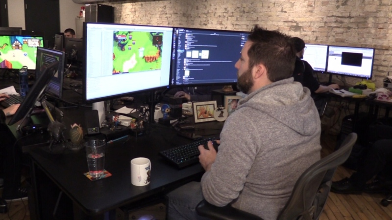 Jeff Evans, founder of Tiny Titan Studios, works on the new game Everbright in London, Ont. in this file photo. (Celine Zadorsky / CTV London)