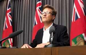 Manitoba Infrastructure Minister Ron Schuler speaks to media in Winnipeg on Thursday, July 26, 2018. THE CANADIAN PRESS/Steve Lambert