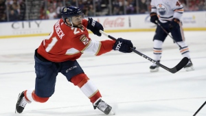 In this Feb. 15, 2020, file photo, Florida Panthers center Vincent Trocheck (21) shoots on the goal during the first period of an NHL hockey game against the Edmonton Oilers, in Sunrise, Fla. (AP Photo/Lynne Sladky)