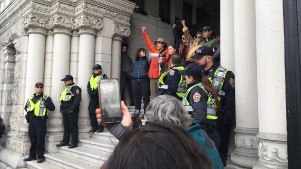 Pipeline protesters handcuff themselves to gates of B.C. legislature