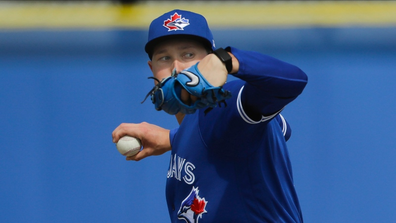 Toronto Blue Jays' Nate Pearson delivers a pitch during live batting practice at a spring training baseball workout Friday, Feb. 21, 2020, in Dunedin, Fla. (AP Photo/Frank Franklin II)