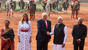 Indian Prime Minister Narendra Modi shakes hand with U.S. President Donald Trump, with first lady Melania Trump, second left, Indian President Ram Nath Kovind, right, and his wife Savita Kovind standing beside them at the Indian Presidential Palace in New Delhi, India, Tuesday, Feb. 25, 2020. (AP Photo/Manish Swarup)