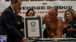 George Hood, a former U.S. Marine and retired Drug Enforcement Administration supervisory special agent, has broken the record for longest plank before, in 2011 when he held it for 1 hour and 20 minutes. But this time he held it for 8 hours, 15 minutes and 15 seconds. (Josef Holic Photography/CNN)