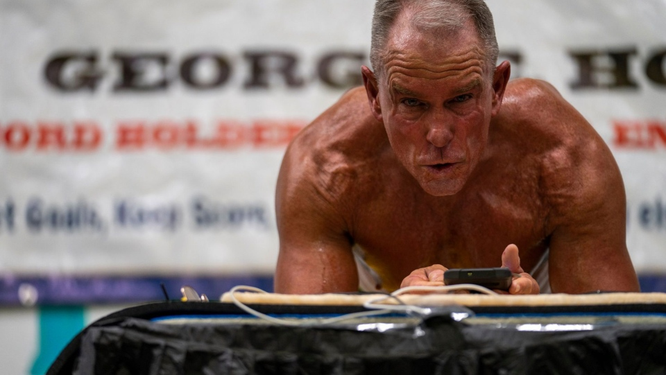 On February 15, George Hood held a plank for 8 hours, 15 minutes and 15 seconds, which Guinness World Records confirmed was the new record. (Josef Holic Photography/AFP)