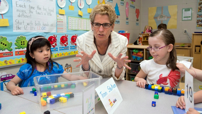 Ontario Liberal leader Kathleen Wynne sits with school children during a campaign stop in Markham, Ontario on Wednesday May 28, 2014, 2014. THE CANADIAN PRESS/Frank Gunn