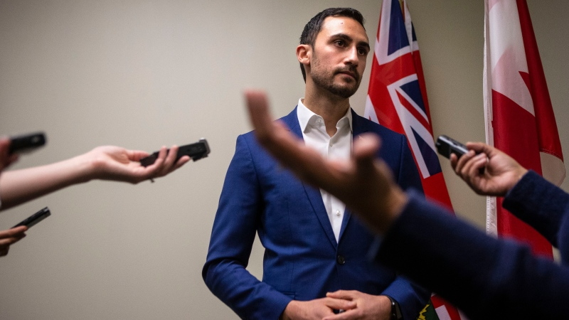Ontario Education Minister Stephen Lecce talks to reporters in a PC caucus office, as protesters join a demonstration organized by the Teacher's Unions outside the Ontario Legislature, in Toronto on Friday, February 21, 2020. THE CANADIAN PRESS/Chris Young