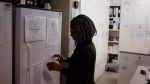 A pharmacist looks at documents on a fridge containing a trial vaccine against HIV on the outskirts of Cape Town, South Africa in this file photo. (AP Photo/Schalk van Zuydam)