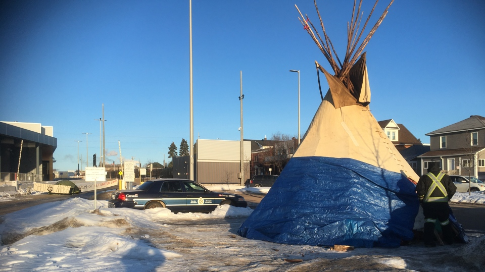 Protesters have erected a teepee at bridge entranc
