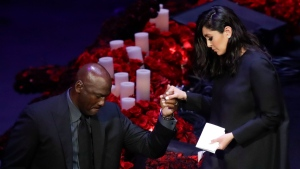 Vanessa Bryant is helped off the stage by former NBA player Michael Jordan after speaking during a celebration of life for her husband Kobe Bryant and daughter Gianna Monday, Feb. 24, 2020, in Los Angeles. (AP Photo/Marcio Jose Sanchez)
