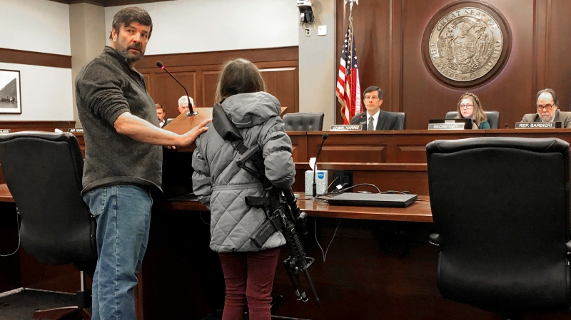Charles Nielsen, 58, and his 11-year-old granddaughter, Bailey Nielsen, testify before a House panel at the Idaho Statehouse on Monday. Feb. 24, 2020 in Boise, Idaho. (AP Photo/Keith Ridler)