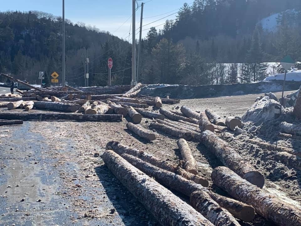 Logs spilled all over Hwy 144 in Sudbury, between Dowling and Onaping, after truck rollover. Feb. 25/20 (Credit: Jodi Callahan Cormier)