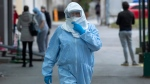 A health worker wears protective suit at the infectious disease clinic in Zagreb, Croatia, where the first coronavirus case in Croatia is hospitalized, Tuesday, Feb. 25, 2020. (AP Photo/Darko Bandic)