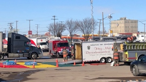 The Saskatoon Fire Department hazmat unit on scene at the Canada Post distribution centre on 51st Street on Feb. 25, 2020. (Francois Biber/CTV Saskatoon)