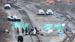 Police look on as protesters camp on GO Transit railroad tracks in Hamilton, Ont., on Tuesday, Feb. 25, 2020, as they protest in solidarity with Wet'suwet'en Nation hereditary chiefs attempting to halt construction of a natural gas pipeline on their traditional territories. THE CANADIAN PRESS/Frank Gunn