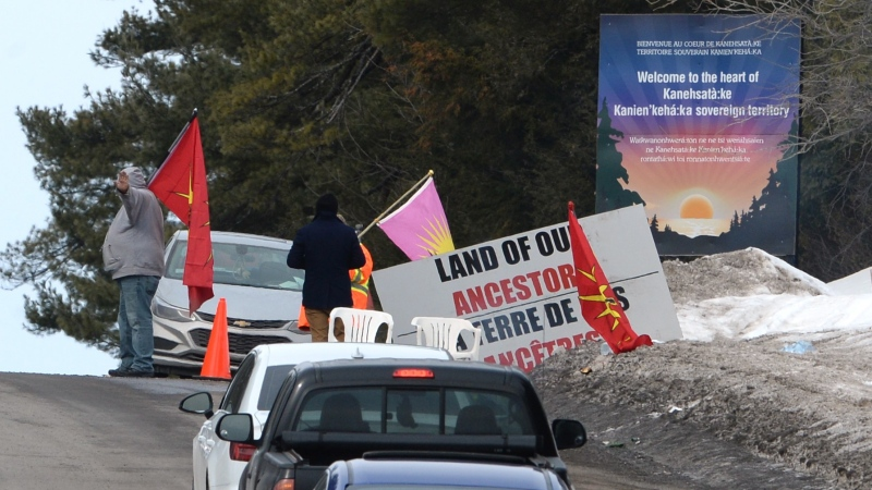 People gather at a protest in Kahnawake, Que. on Tuesday, Feb. 25, 2020, in solidarity with Wet'suwet'en Nation hereditary chiefs attempting to halt construction of a natural gas pipeline on their traditional territories. THE CANADIAN PRESS/Ryan Remiorz