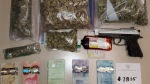 Orillia OPP display money, drugs and a pellet gun allegedly seized during a traffic stop on Highway 400. (OPP/Twitter)