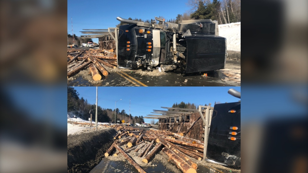 Truck carrying logs rolled over on Hwy 144