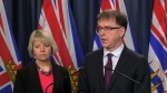 Provincial health officer Dr. Bonnie Henry, left, and B.C. Health Minister Adrian Dix speak to reporters about protecting the privacy of COVID-19 patients on Feb. 25, 2020.